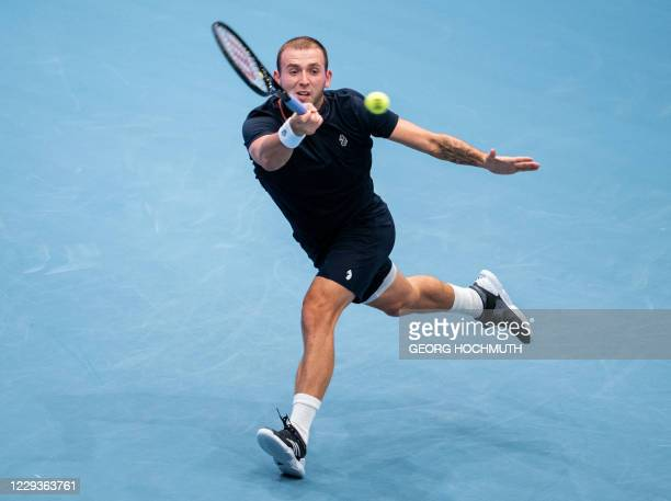 Britain's Daniel Evans returns the ball to Bulgaria's Grigor Dimitrow during their quarter-final match of the ATP tennis tournament in Vienna,...