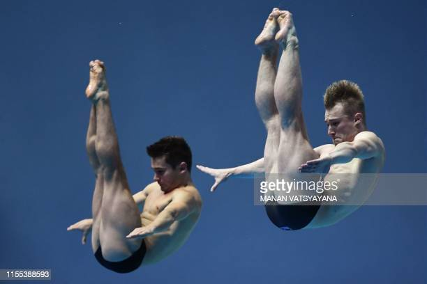 Britain's Daniel Goodfellow and Britain's Jack Laugher compete in the men's synchronised 3m springboard diving final during the 2019 World...