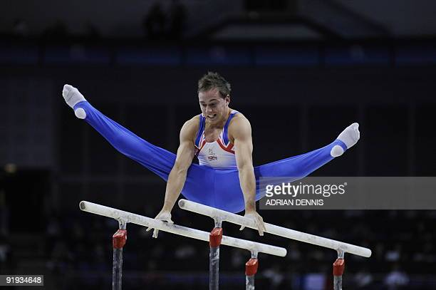 Britain's Daniel Keatings performs in the parallel bars event in the men's individual allaround final during the Artistic Gymnastics World...