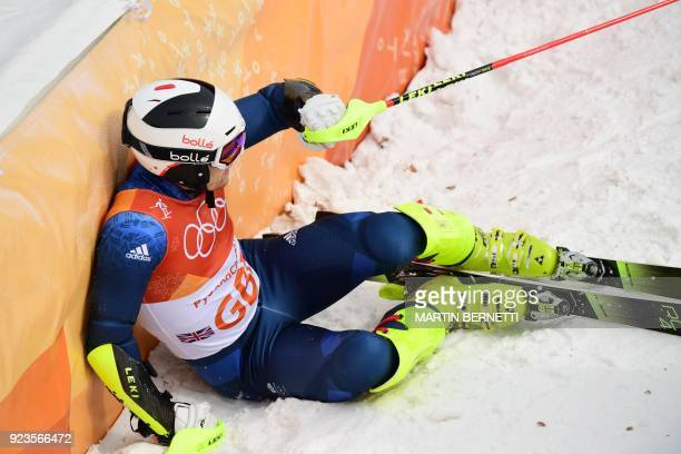Britain's Dave Ryding reacts after competing in the Alpine Skiing Team Event 1/8 finals at the Jeongseon Alpine Center during the Pyeongchang 2018...