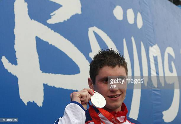Britain's David Davies poses with his medal after the award ceremony following the Men's Swimming 10 km marathon final of the 2008 Beijing Olympic...