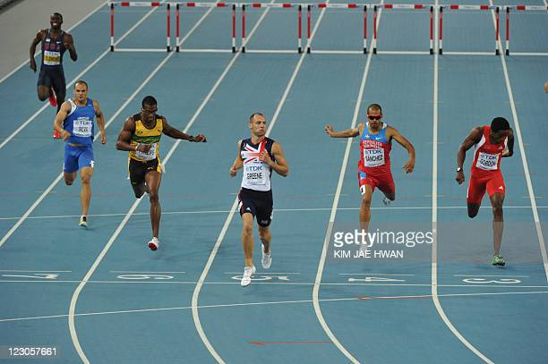 Britain's David Greene leads the field in the men's 400 metres hurdles semifinal at the International Association of Athletics Federations World...