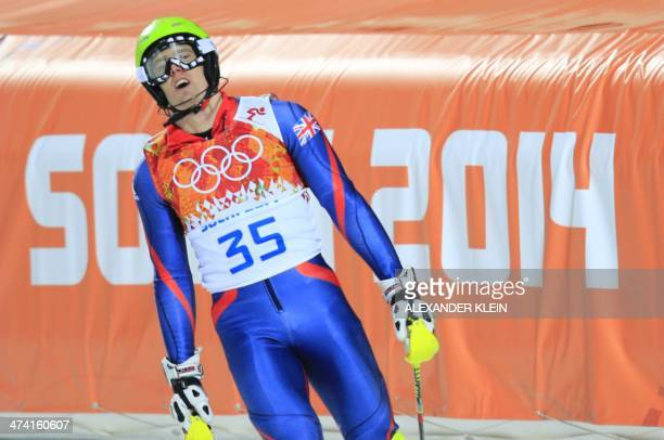 Britain's David Ryding reacts in the finish area during the Men's Alpine Skiing Slalom Run 2 at the Rosa Khutor Alpine Center during the Sochi Winter...