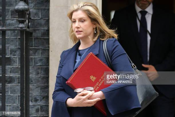 Britain's Defence Secretary and Minister for Women and Equalities Penny Mordaunt leaves 10 Downing Street in central London on June 11 after...