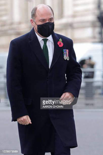 Britain's Defence Secretary Ben Wallace, wearing a protective face covering to combat the spread of the coronavirus, arrives to attend a service to...