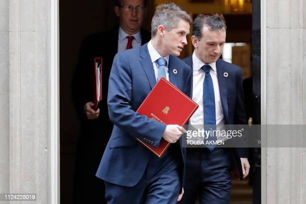 Britain's Defence Secretary Gavin Williamson and Britain's Wales Secretary Alun Cairns leave after attending the weekly cabinet meeting at 10 Downing...
