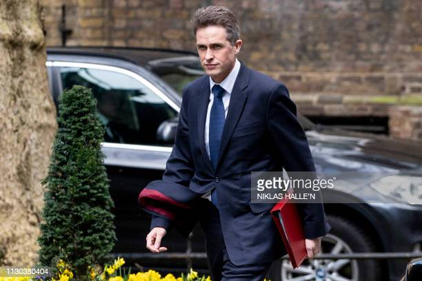 Britain's Defence Secretary Gavin Williamson arrives in Downing Street in London on March 14 ahead of a further Brexit vote British MPs will vote...