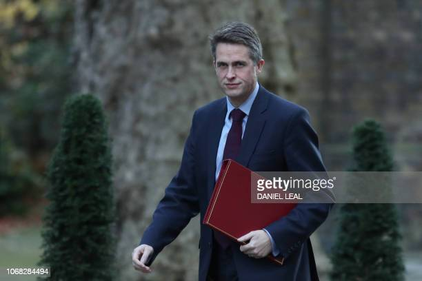 Britain's Defence Secretary Gavin Williamson attends the weekly meeting of the cabinet at 10 Downing Street in London on December 4 2018