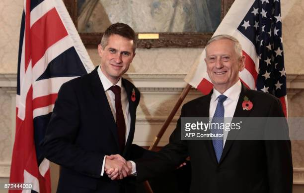 Britain's Defence Secretary Gavin Williamson shakes hands with US Defence Secretary James Mattis during their meeting at the Ministry of Defence in...