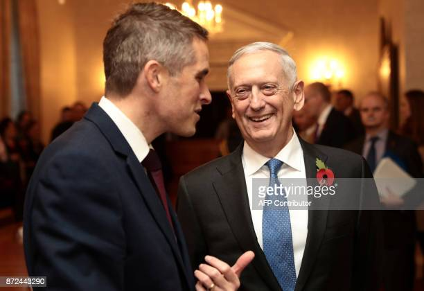 Britain's Defence Secretary Gavin Williamson talks with US Defence Secretary James Mattis before their meeting at the Ministry of Defence in central...