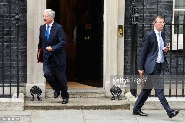 Britain's Defence Secretary Michael Fallon and Attorney General Jeremy Wright leave number 10 Downing Street following an extended Cabinet meeting on...
