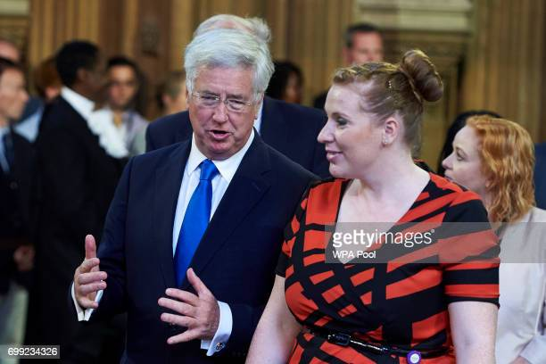 Britain's Defence Secretary Michael Fallon and Shadow Secretary of State for Education Angela Rayner walk across the Central Lobby of the Palace of...