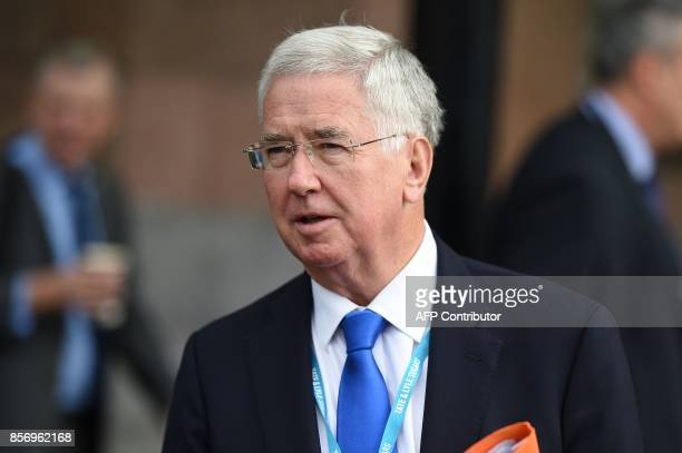 Britain's Defence Secretary Michael Fallon arrives to attend day 3 of the Conservative Party annual conference in Manchester northwest England on...