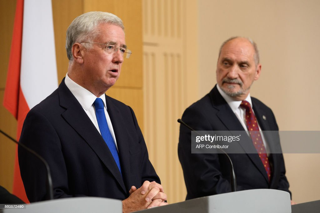 Britain's Defence Secretary Michael Fallon (L) speaks as Poland's Defence Minister Antoni Macierewicz (R) looks on during a joint UK/Poland press conference following bilateral talks at the Foreign and Commonwealth Office in London on October 12, 2017. / AFP PHOTO / POOL / Leon Neal
