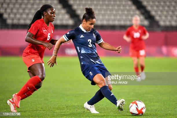 Britain's defender Demi Stokes controls the ball in front of Canada's forward Deanne Rose during the Tokyo 2020 Olympic Games women's group E first...