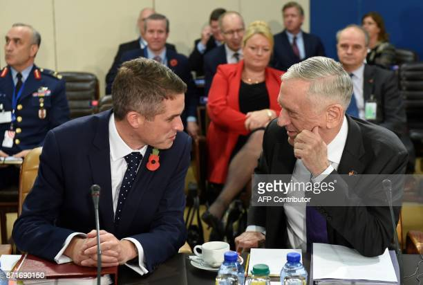 Britain's defense minister Gavin Williamson talks with Us defense minister James Mattis during a defense minister meeting at the Nato headquarters in...