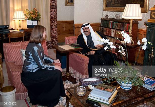 Britain's Deputy Leader of the Opposition Harriet Harman talks with Qatar's Emir Sheikh Hamad bin Khalifa alThani before a banquet held during his...