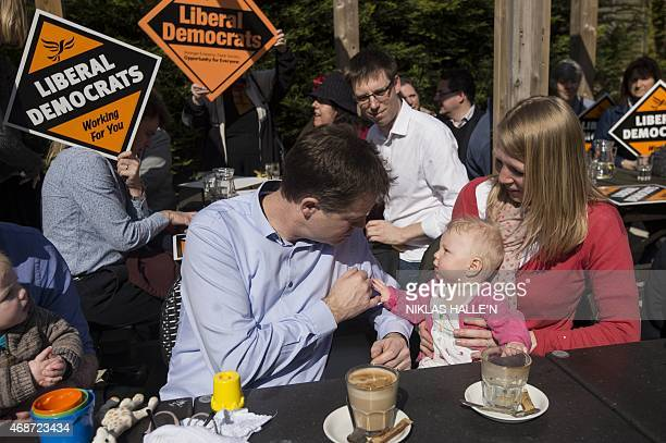 Britain's Deputy Prime Minister and leader of the Liberal Democrats Nick Clegg speaks to local residents while campaigning in Surbiton Kingston on...