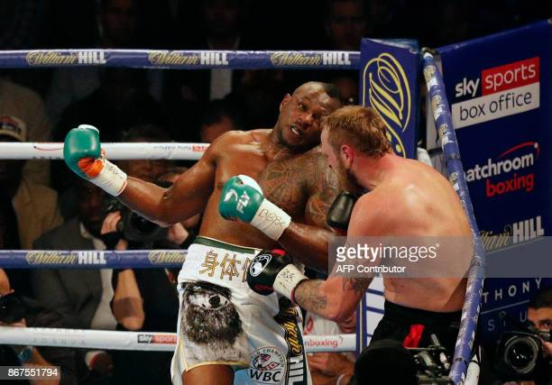Britain's Dillian Whyte fights Finland's Robert Helenius during their WBC silver Heavyweight Championship at The Principality Stadium in Cardiff on...