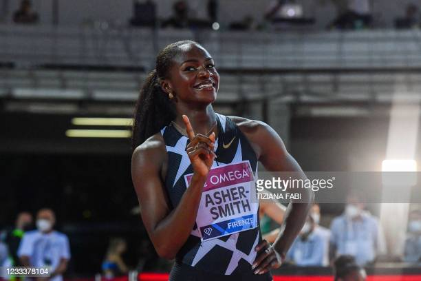 Britain's Dina Asher-Smith celebrates after winning the 200m Women during the Diamond League athletics meeting on June 10, 2021 at the Asics Firenze...