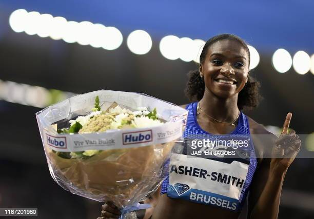 Britain's Dina AsherSmith celebrates after winning the women's 100m race at the 2019 edition of the AG Insurance Memorial Van Damme IAAF Diamond...