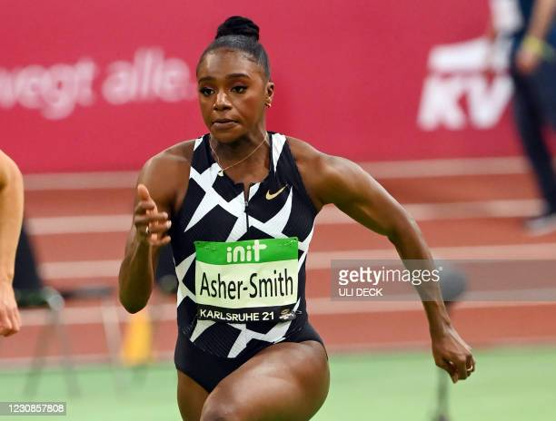 Britain's Dina Asher-Smith competes in a heat of the 60m event at the IAAF World Indoor Athletics Championships in Karlsruhe, southern Germany, on...