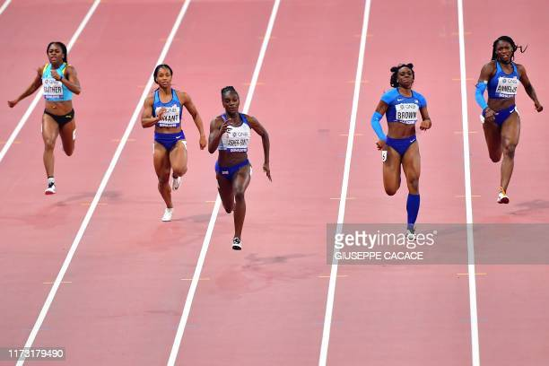 Britain's Dina AsherSmith leads on her way to winning the Women's 200m final at the 2019 IAAF Athletics World Championships at the Khalifa...