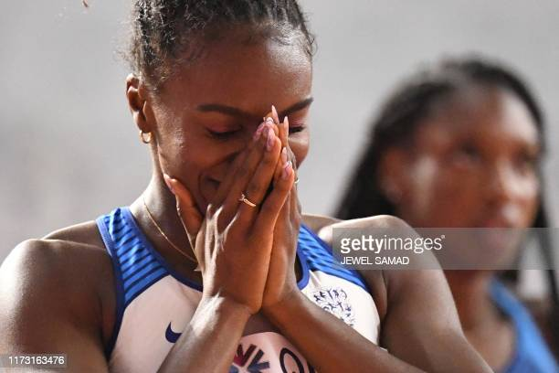 Britain's Dina AsherSmith reacts after winning the Women's 200m final at the 2019 IAAF Athletics World Championships at the Khalifa International...