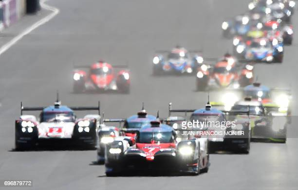 TOPSHOT Britain's driver Mike Conway competes on his Toyota TS050 Hybrid N°7 ahead of Switzerland's driver Sebastien Buemi on his Toyota TS050 Hybrid...