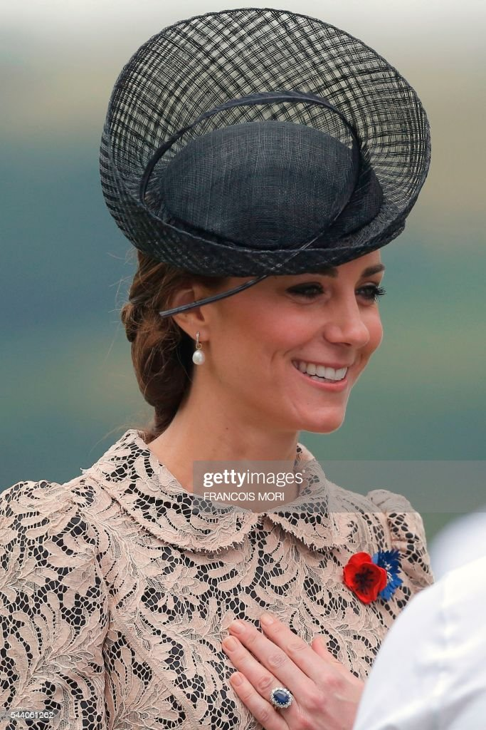 Britain's Duchess Catherine of Cambridge reacts as she attends the memorial ceremony on July 1, 2016, at the Thiepval Memorial in Thiepval, during which Britain and France will mark the 100 years since soldiers emerged from their trenches to begin one of the bloodiest battles of World War I (WWI) at the River Somme. Under grey skies, unlike the clear sunny day that saw the biggest slaughter in British military history a century ago, the commemoration kicked off at the deep Lochnagar crater, created by the blast of mines placed under German positions two minutes before the attack began at 7:30 am on July 1, 1916. / AFP / POOL / Francois Mori