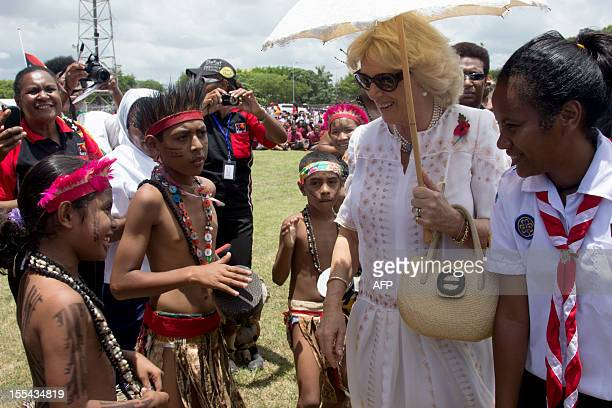 Britain's Duchess of Cornwall Camilla meets young children at Sir John Guise stadium in Port Moresby on November 4 2012 Papua New Guinea is the first...