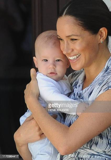 Britain's Duchess of Sussex Meghan, hold her baby son Archie as she and the husband meet with Archbishop Desmond Tutu and his wife Leah at the Tutu...