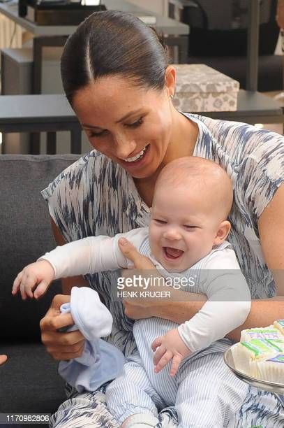 Britain's Duchess of Sussex Meghan hold their baby son Archie as she and the Duke meet with Archbishop Desmond Tutu and his wife at the Tutu Legacy...