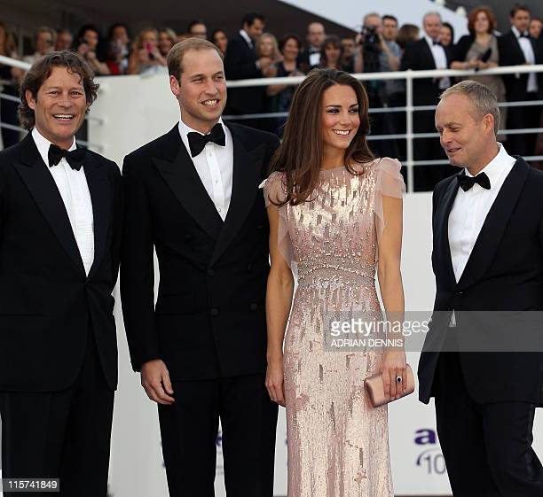 Britain's Duke and Duchess of Cambridge Prince William and Catherine pose for a photograph alongside Arpad Busson Founding Chairman of ARK and Ian...