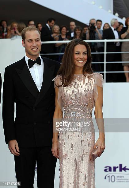 Britain's Duke and Duchess of Cambridge Prince William and Catherine pose as they arrive for a charity gala dinner their first official royal...