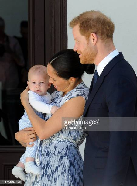 Britain's Duke and Duchess of Sussex, Prince Harry and his wife Meghan hold their baby son Archie as they meet with Archbishop Desmond Tutu and his...
