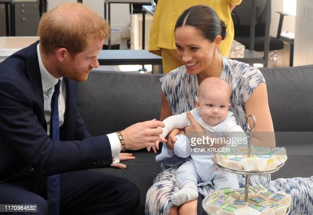 Britain's Duke and Duchess of Sussex, Prince Harry and his wife Meghan hold their baby son Archie as they meet with Archbishop Desmond Tutu at the...