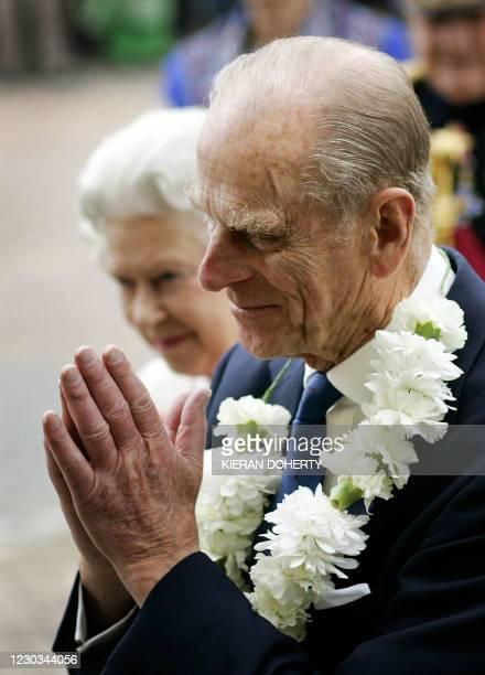 Britain's Duke of Edinburgh and Queen Elizabeth arrive for a visit to Gurdwara Sri Guru Singh Sabha in Hounslow, west London, 15 October, 2004....