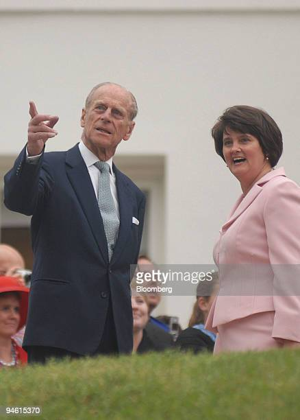 Britain's Duke of Edinburgh Prince Phillip left and the first lady of Virginia Lisa Collis speak during a royal event at the Virginia State Capitol...