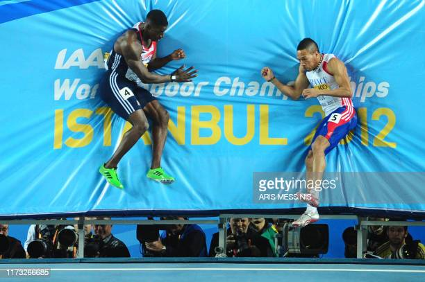 Britain's Dwain Chambers and France's Emmanuel Biron slam into the crash mat at the end of their men's 60m semifinal at the 2012 IAAF World Indoor...