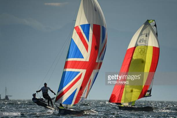 Britain's Dylan Fletcher and Stuart Bithell and Spain's Diego Botin Sanz De Sautuola and Iago Lopez Marra compete in the men's skiff 49er race during...