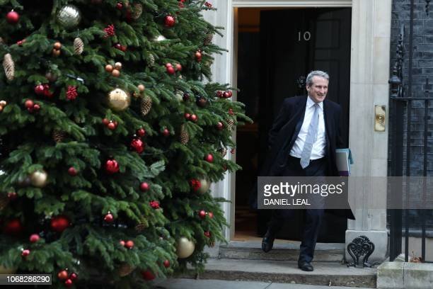 Britain's Education Secretary Damian Hinds leaves after attending the weekly meeting of the cabinet at 10 Downing Street in London on December 4 2018...