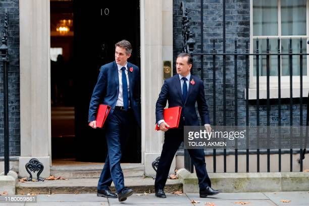 Britain's Education Secretary Gavin Williamson and Britain's Wales Secretary Alun Cairns leaves number 10 Downing Street in central London on...