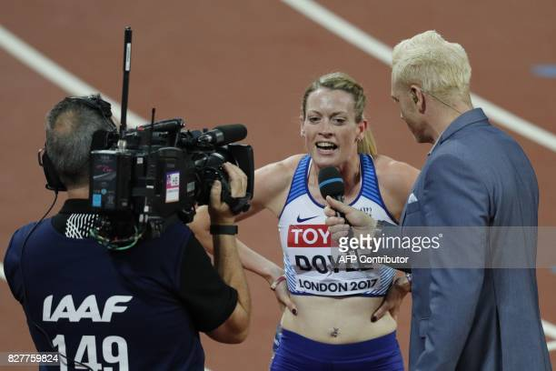 Britain's Eilidh Doyle gives an interview after she competes in the semifinals of the women's 400m hurdles athletics event at the 2017 IAAF World...