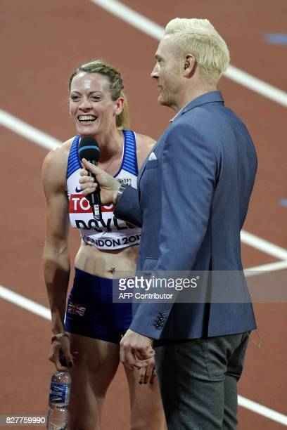 Britain's Eilidh Doyle gives an interview to Ewan Thomas after she competes in the semifinals of the women's 400m hurdles athletics event at the 2017...