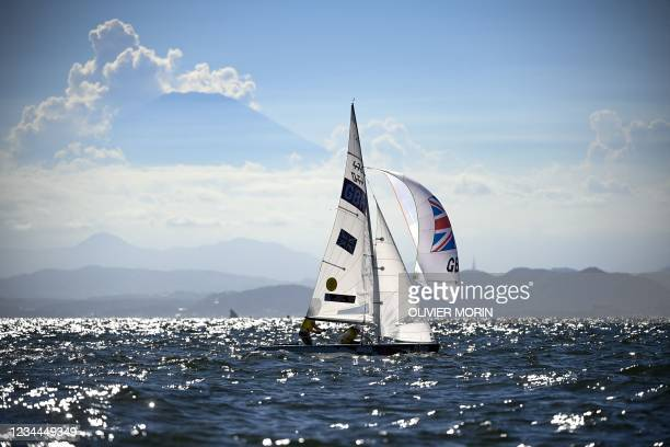 Britain's Eilidh Mcintyre and Hannah Mills sail in front of Mount Fuji during the women's two-person dinghy 470 medal race during the Tokyo 2020...