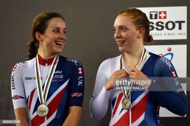 Britain's Elinor Barker and Emily Nelson chat as they wear their silver medals during the podium ceremony for the women's madison at the 2017 Track...