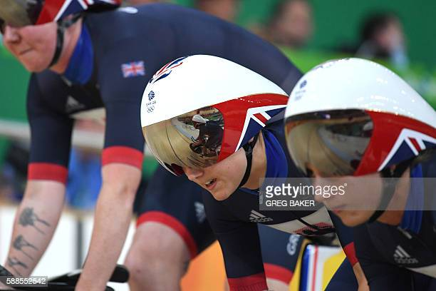 Britain's Elinor Barker Britain's Katie Archibald and Britain's Joanna RowsellShand compete in the women's Team Pursuit qualifying track cycling...