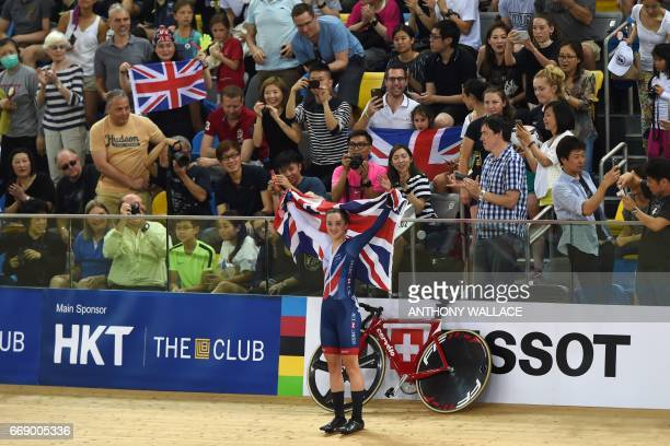 Britain's Elinor Barker holds the Union Jack flag after winning the women's points race final at the Hong Kong Velodrome during the Track Cycling...