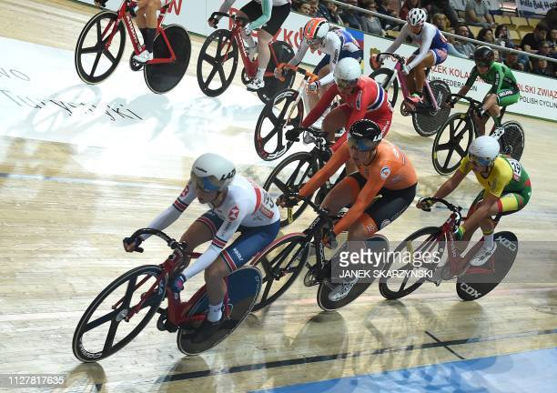 Britain's Elinor Barker leads in front of the Netherlands' Kirsten Wild during the women' scratch competition of the UCI Track Cycling World...